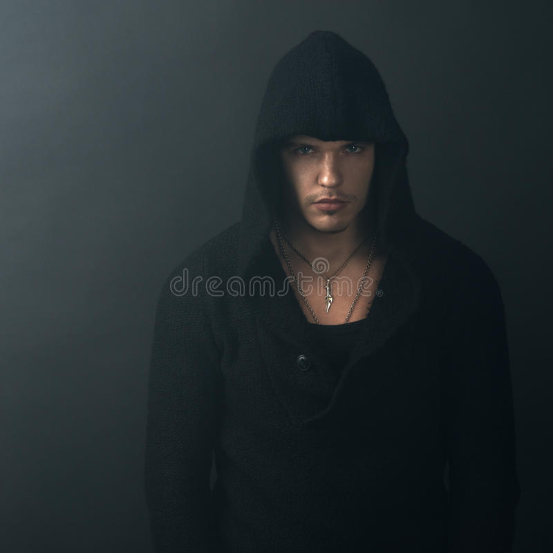 Man in black hoodie looking confidently. Man in a black hoodie looking confidently royalty free stock photos