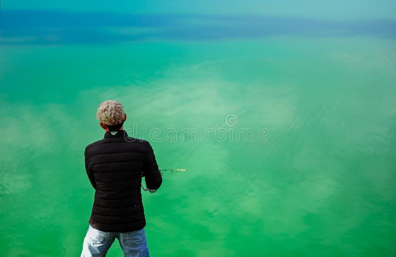 Man in Black Jacket Standing in Front of Sea royalty free stock photos