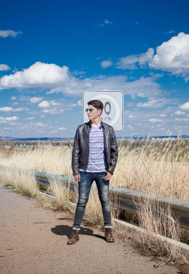 Man in Black Leather Zip-up Jacket and Black Jeans Wearing Black Sunglasses royalty free stock photos