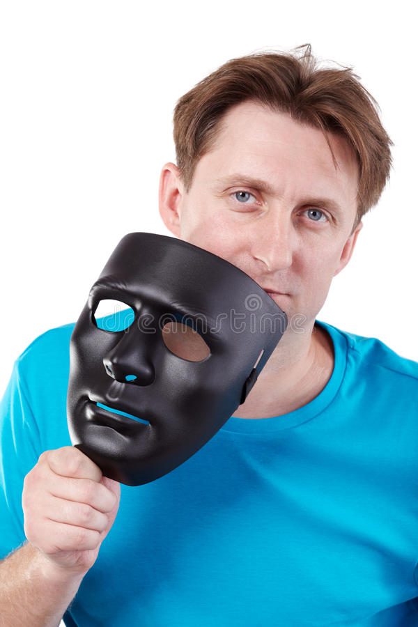 Man With Black Mask In Hand Stock Photos