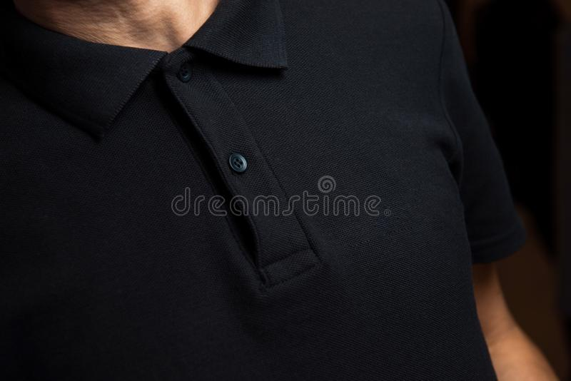 Man in black polo. Black polo fits good.It made from cotton,classical collar with buttons.The man is ready to work royalty free stock photo