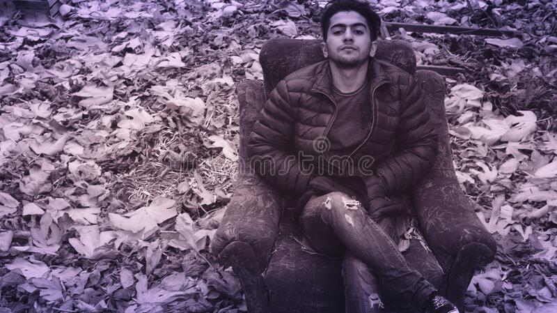 Man In Black Puffer Jacket And Distress Jeans Sitting In Couch Free Public Domain Cc0 Image