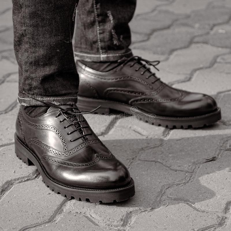 A man in the street wearing black shoes royalty free stock images