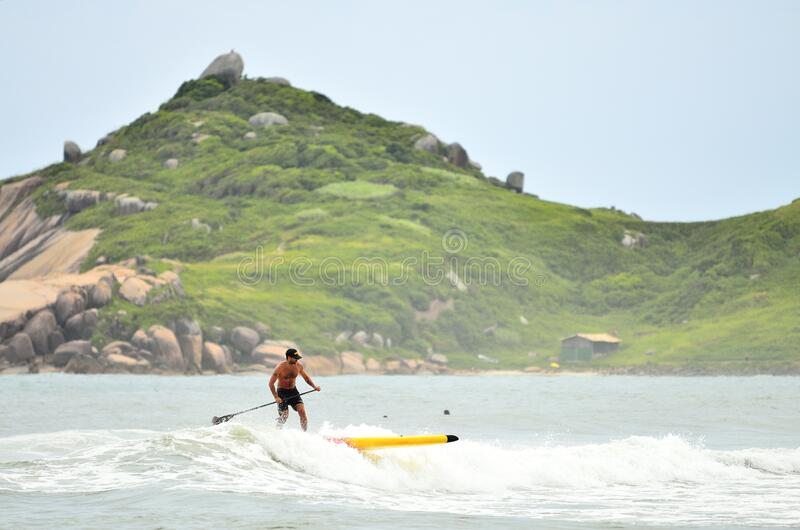 Man In Black Shorts Surfing Under Blue Sky During Daytime Free Public Domain Cc0 Image