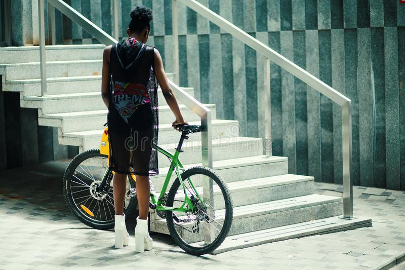 Man in Black Sleeveless Shirt Holding Green Mountain Bike Near Metal Staircase royalty free stock images