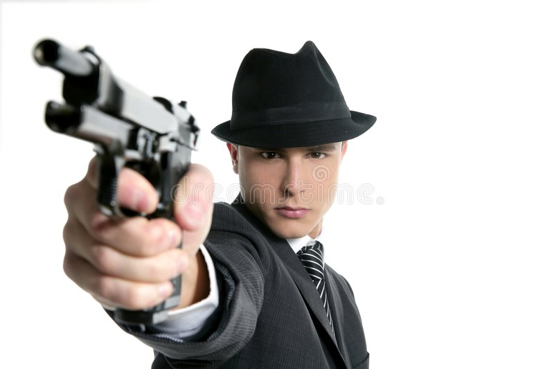 Man with black suit and gun stock photo