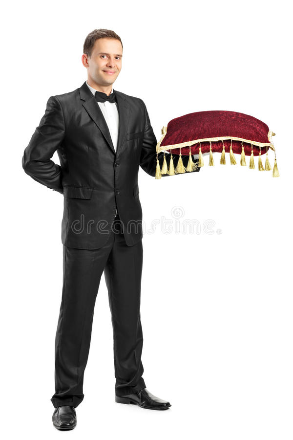 Download Man In A Black Suit Holding A Pillow Stock Photo - Image: 20835964