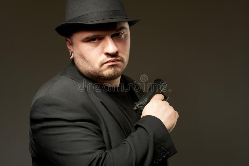 Download Man In Black Suite With Gun. Stock Image - Image: 18670529