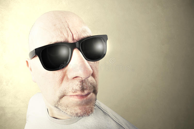 Man with black sunglasses looking forward royalty free stock image