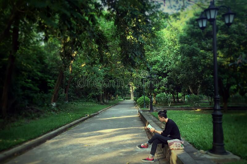 Man In Black Sweater Reading Book While Seated On Concrete Free Public Domain Cc0 Image
