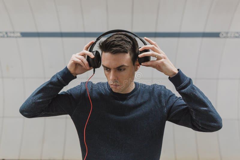 Man in Black Sweater Wearing Black Headphones royalty free stock photography