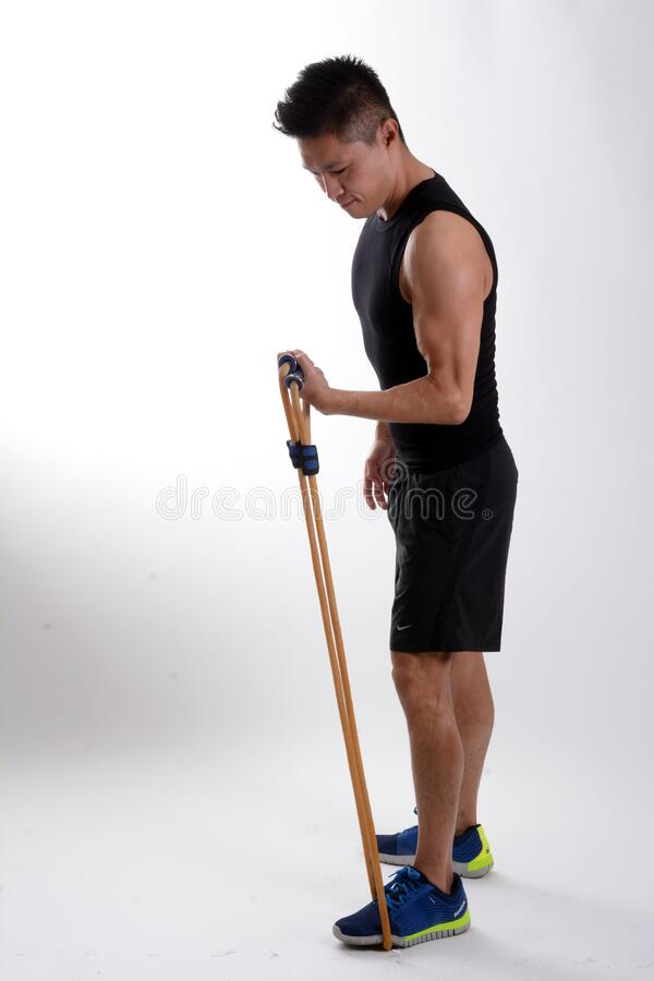 Man In Black Tank Top Holding Brown Stretching Rope Free Public Domain Cc0 Image