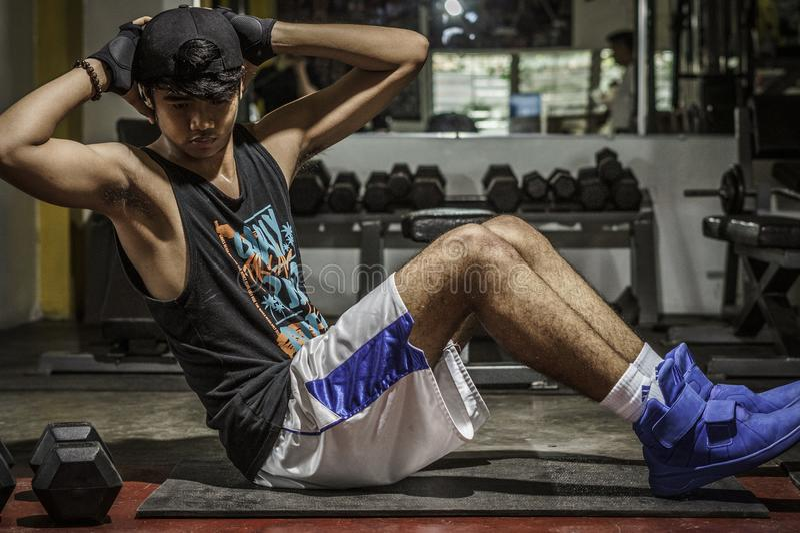 Man In Black Tank Top Inside Gym royalty free stock photos