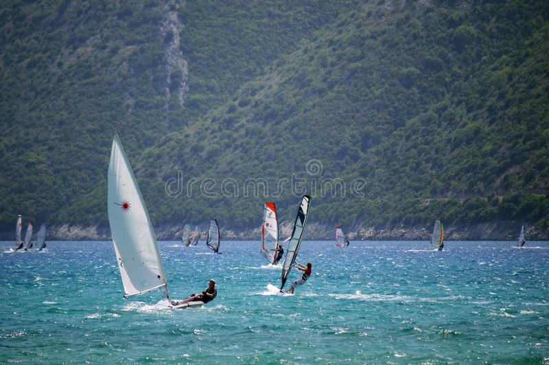 Man in Black Top Ridding Sailboat stock photography