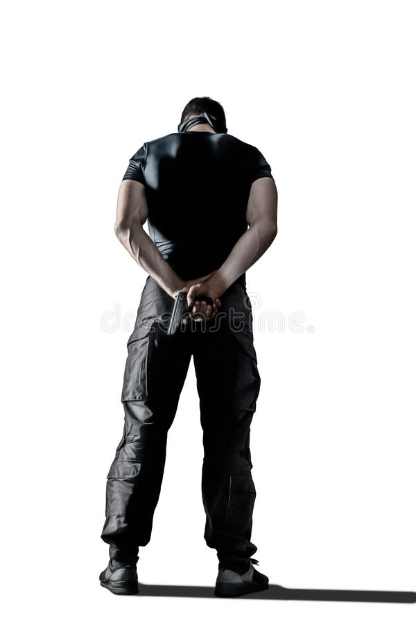 Man in black uniform and mask standing with gun isolated stock photos