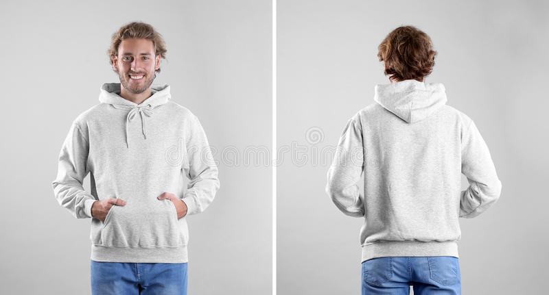 Man in blank hoodie sweater on light background, front and back views. royalty free stock photo