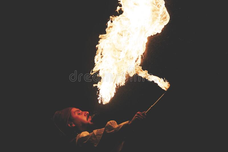 Man Blowing Fire during Nighttime stock image