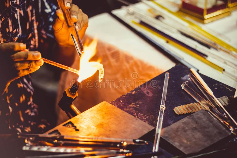 Blowing glass. A man Blowing glass use fire gas royalty free stock photos