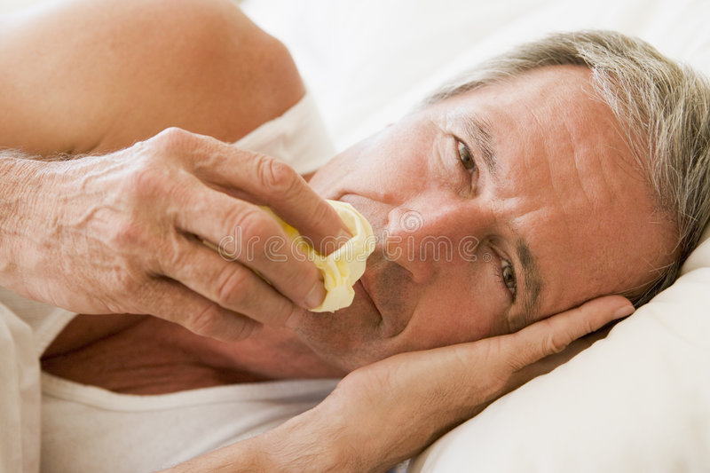Man Blowing His Nose royalty free stock photo