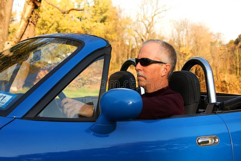 Man In A Blue Convertible Royalty Free Stock Image