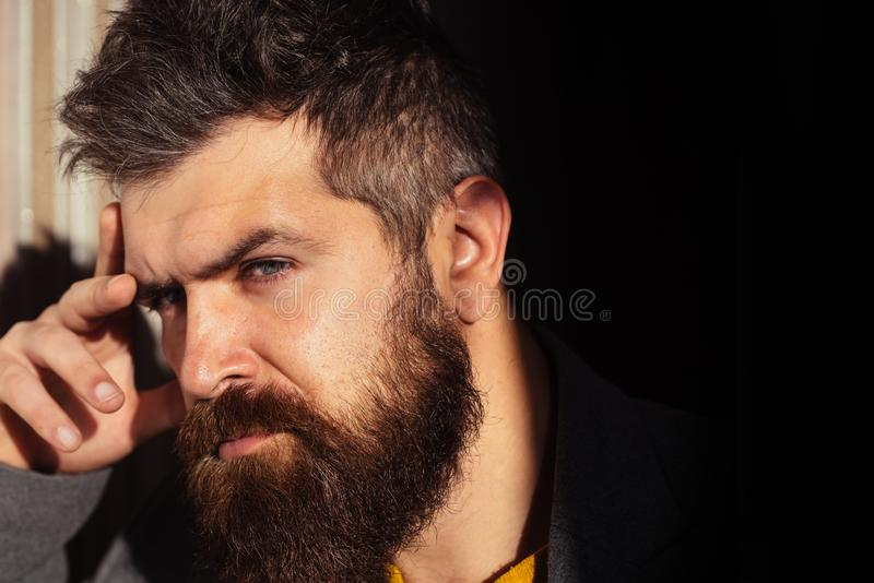 Man with blue eyes. Thoughts, reflections. Adult bearded male. Handsome guy. Hipster think. Stylish man. royalty free stock photography