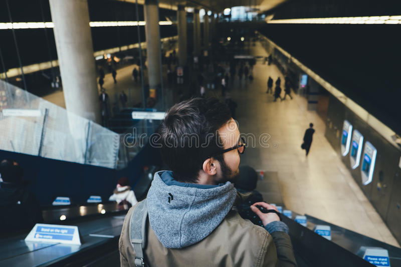 Download Man in Blue Hoodie stock photo. Image of escalator, person - 84996792