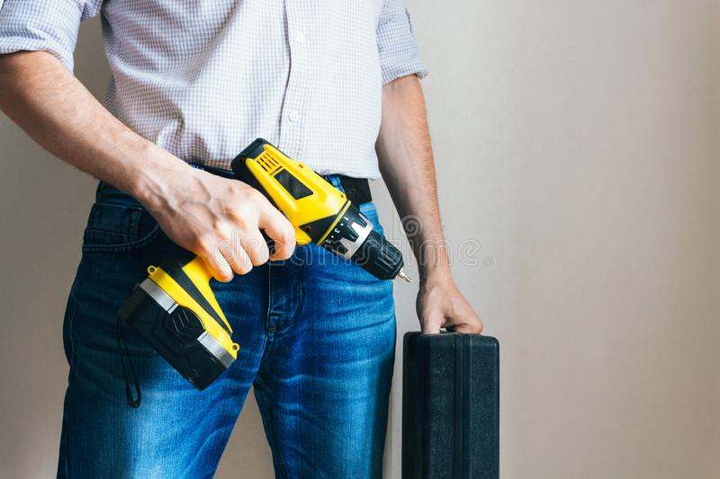 man with a suitcase of tools and a screwdriver stock image