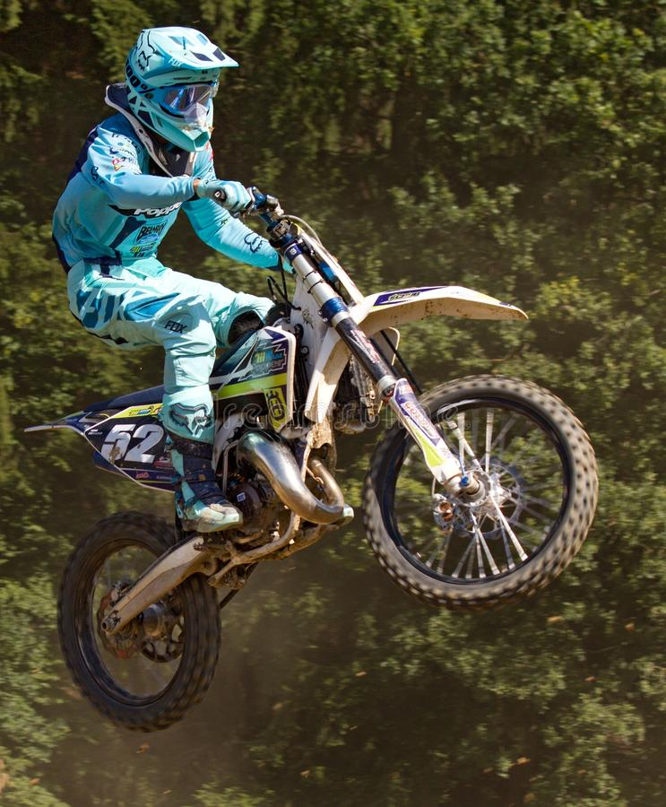 Man In Blue Mtx Suit Riding Blue And Yellow Dirt Motorcycle In Air Free Public Domain Cc0 Image