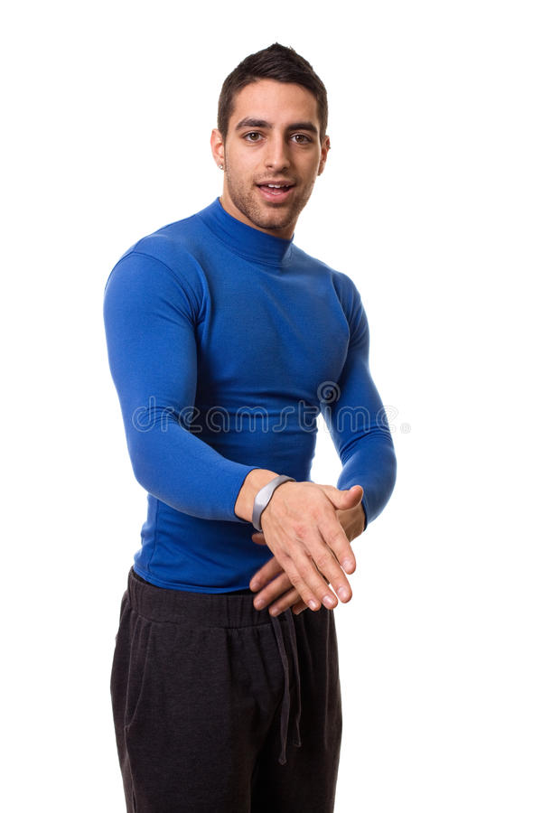 Man in Blue Shirt. Man in blue compression shirt and shorts. Studio shot over white stock photos