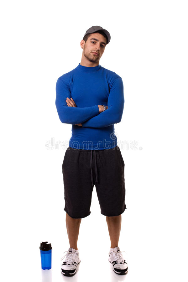 Man in Blue Shirt. Man in a blue compression shirt. Studio shot over white royalty free stock photography