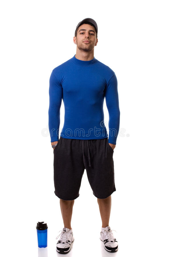 Man in Blue Shirt. Man in a blue compression shirt. Studio shot over white stock photo