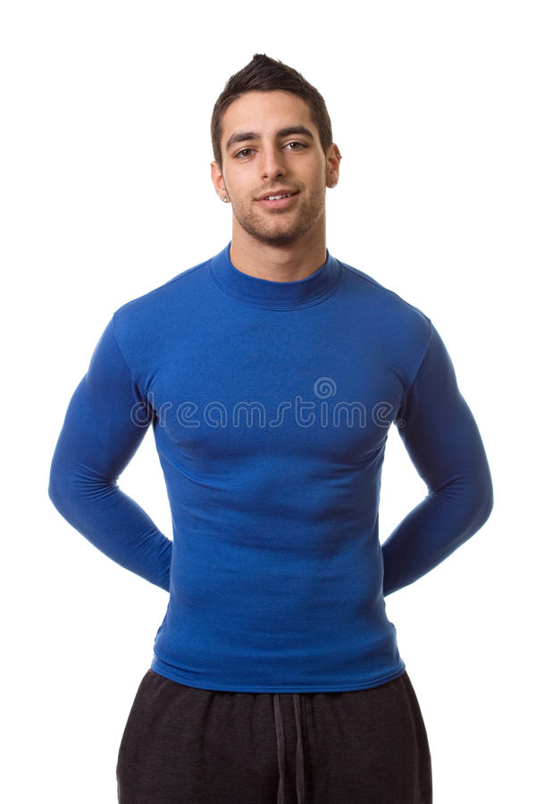 Man in Blue Shirt. Man in a blue compression shirt. Studio shot over white stock images
