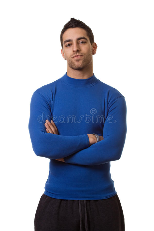 Man in Blue Shirt. Man in a blue compression shirt. Studio shot over white royalty free stock photo