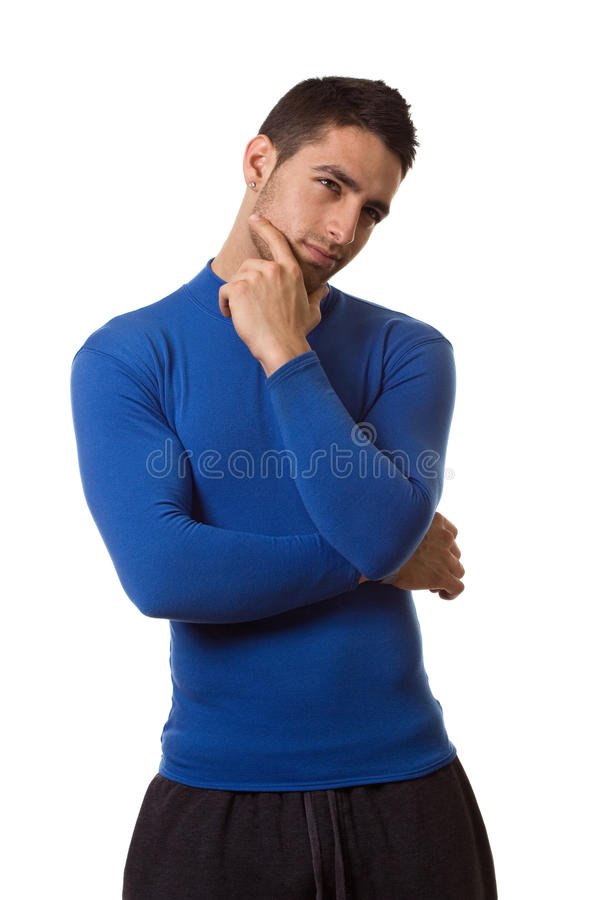 Man in Blue Shirt. Man in a blue compression shirt. Studio shot over white stock image