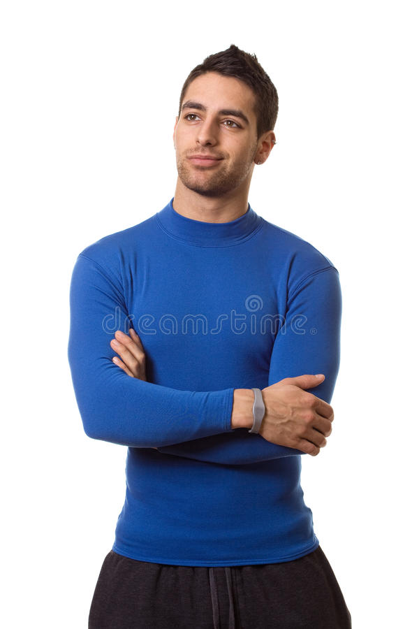 Man in Blue Shirt. Man in a blue compression shirt. Studio shot over white royalty free stock image