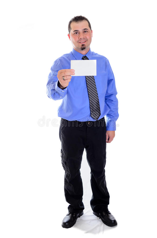 Man in blue shirt and tie holding blank card smiling. A smiling business man in blue shirt and tie holding a blank card and smiling royalty free stock photos