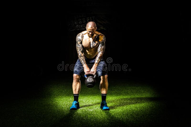 Man in Blue Shorts Carrying Brown Exercise Equipments stock images