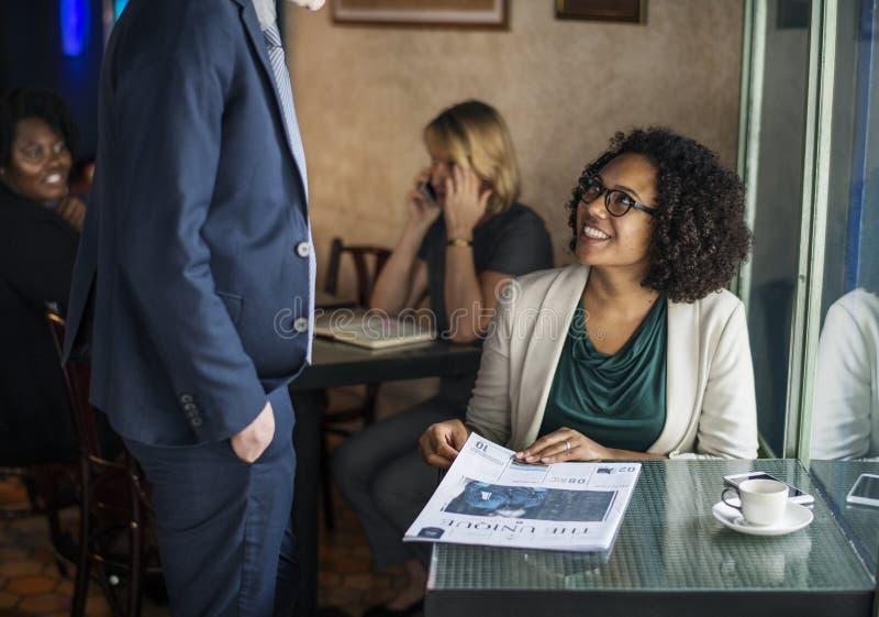 Man in Blue Suit Jacket in Front of Woman Sitting Near Window stock photo