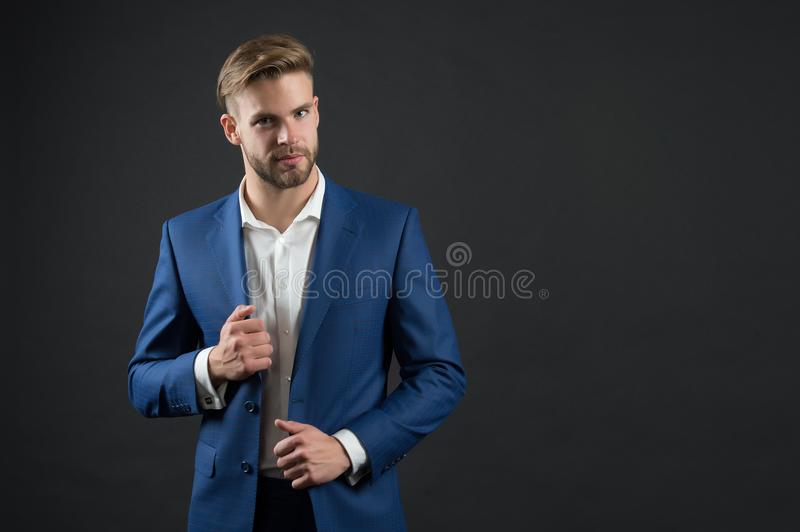 Man in blue suit jacket and shirt. Businessman with bearded face and stylish hair. Manager in formal outfit. Fashion, style and dr stock photo