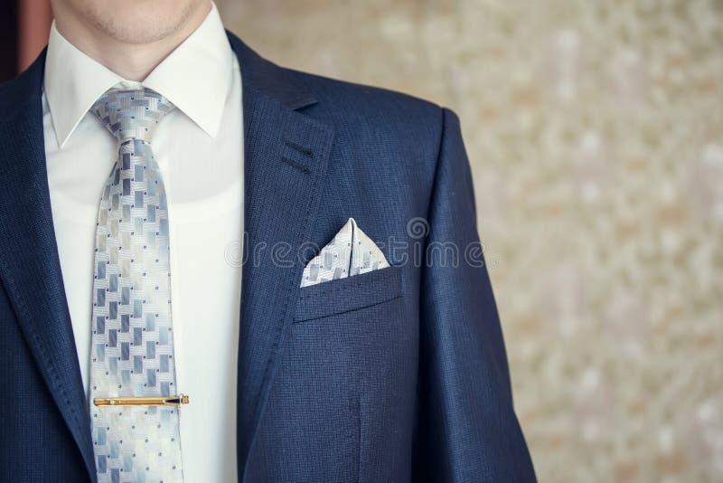 Man in blue suit. With tie, tie clip and handkerchief. Focused on handkerchief stock images