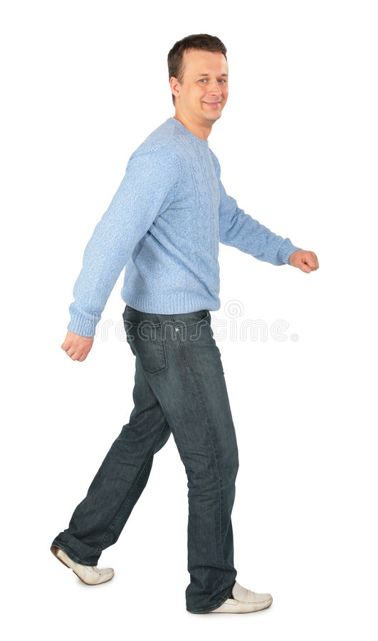 Man in blue sweater goes royalty free stock image