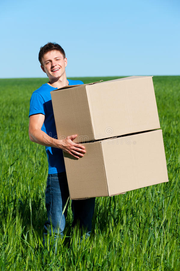 Download Man In Blue T-shirt Carrying Boxes Stock Photo - Image: 21814490