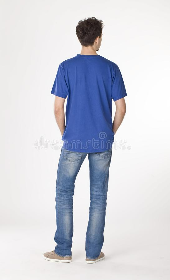 Daily man in blue shirt standing back royalty free stock images