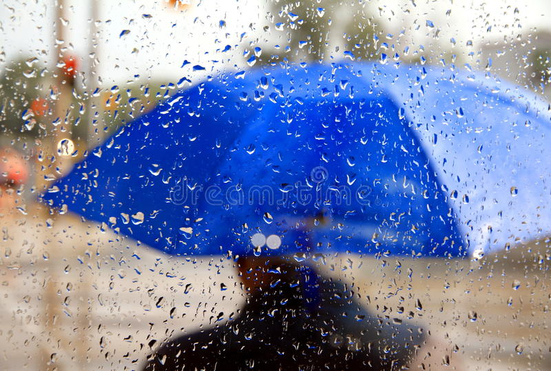 Man With Blue Umbrella