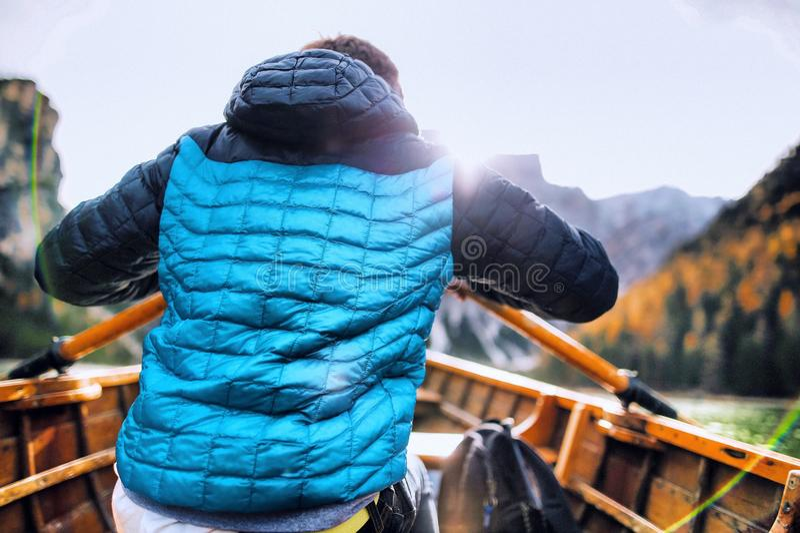 Man In Blue Vest Holding Paddle Sitting Inside Boat Free Public Domain Cc0 Image