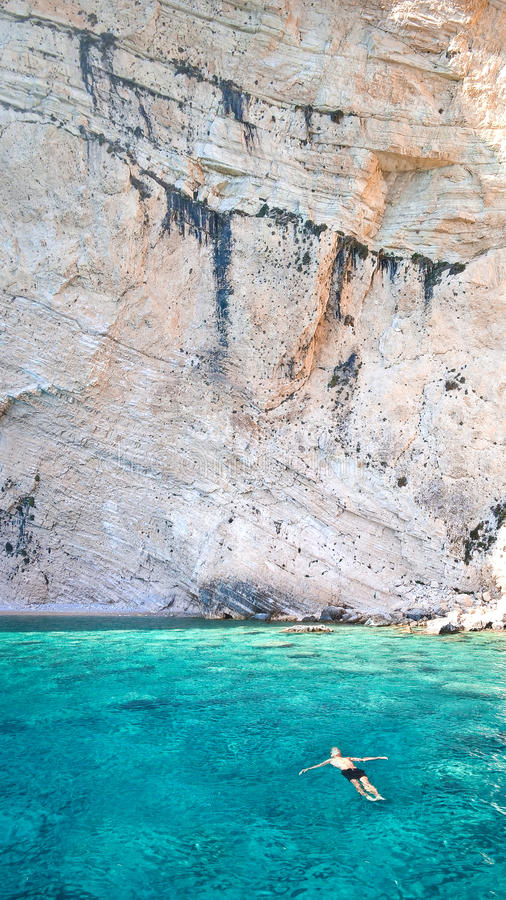 Man In Blue Waters Along Cliff Free Public Domain Cc0 Image