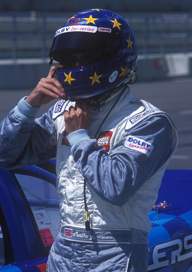 Man In Blue And And White Racer Suit Wearing His Blue And Yellow Star Full Face Helmet Free Public Domain Cc0 Image