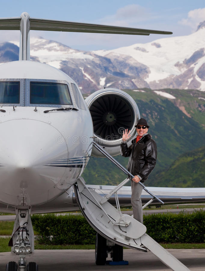 Man boarding a private jet stock photos