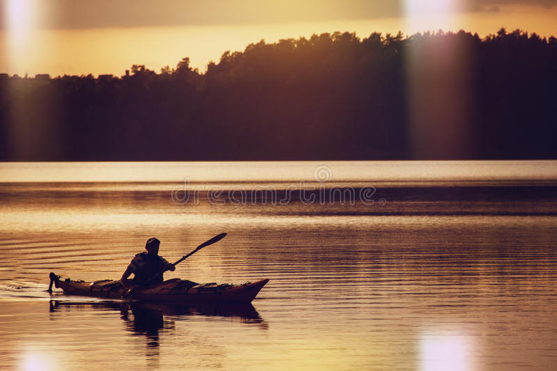 The man in a boat on the lake stock images