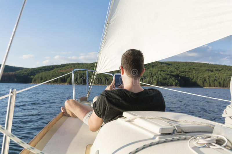 Man on a boat in a lake royalty free stock image